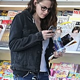 Kristen whipped out her phone.