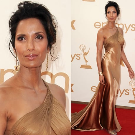 Pictures of Padma Kakshmi in Armani Prive bronze dress on the red carpet at the 2011 Emmy Awards