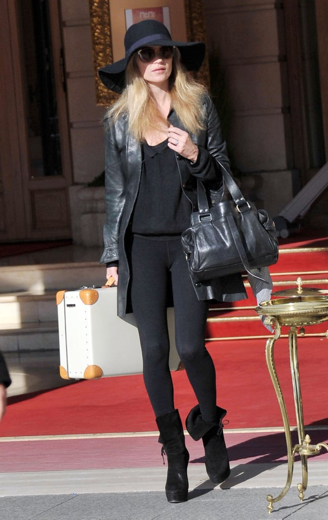Kate Moss held a chic white case as she left the Ritz yesterday and headed to Daylight photo studios. The model arrived in France at the weekend in time to party at Givenchy's aftershow bash during Paris Fashion Week. Despite her busy schedule, she found time film a sketch for Comic Relief where she plays Misery Bear's celebrity stalker: watch the funny short here. Kate is also reportedly being considered for a role on The X Factor. She's making time to plan her wedding, and apparently wants Shirley Bassey to sing at the ceremony.