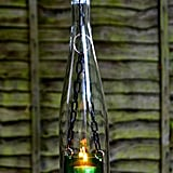Upcycle an old wine bottle and turn it into a hanging candle latern.