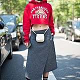 Crop Your Sweatshirt and Wear It With a Wrap Skirt and Waist Bag