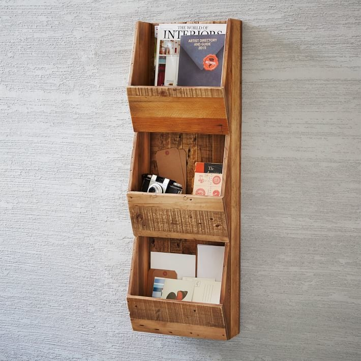 Gather loose items, like greeting cards, magazines, and memorabilia, in a wall-mount storage rack that's easy on the eyes, like this Reclaimed Pine Cubby Shelf ($152, originally $179).