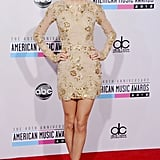 Taylor Swift posed in a short, gold Zuhair Murad ensemble on the red carpet in 2012.