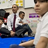 Partaking in story time during a 2014 visit to an elementary school in DC.