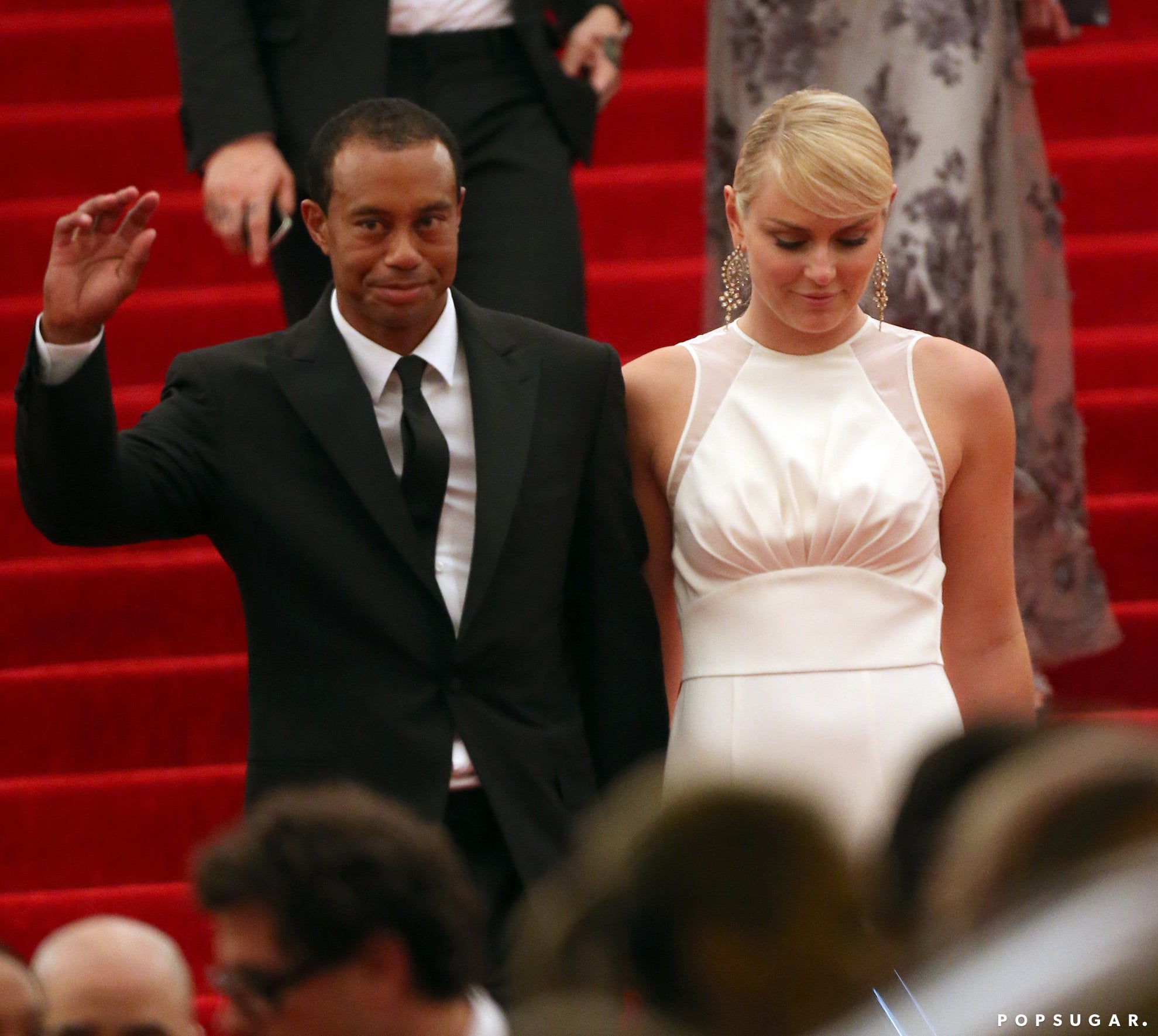 Tiger Woods and Lindsey Vonn left hand in hand.