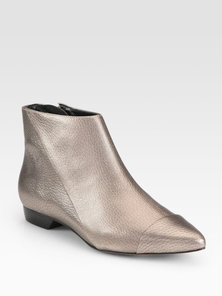 If you're anything like us, you probably already own two or three favorite pairs of heeled ankle boots. Try the footwear staple another way with this pewter-hued flat variety ($395).