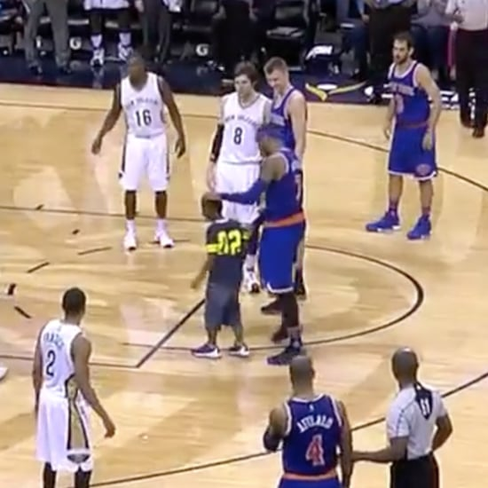 Boy Rushes the Court to Hug Carmelo Anthony