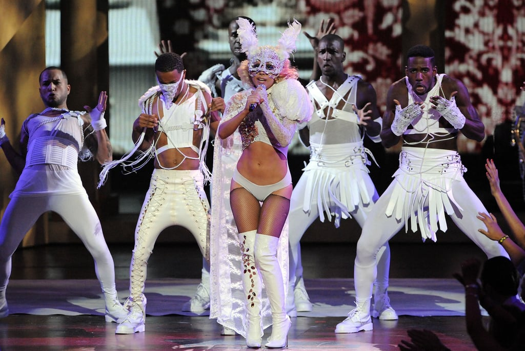 "Exactly ten years ago, Lady Gaga delivered one of the most memorable MTV Video Music Award performances of all time. The pop star was just 23, and had previously released her debut album, The Fame, which spawned runaway hits like ""Just Dance"" and ""Poker Face."" The public was already intrigued by her catchy, unusual music and even more unusual style, but the performance — her first ever at a major award show— would offer a chance to prove her (now indisputable) talent within a live setting.  Her big moment was also preceded by five famous words: ""I'mma let you finish, but . . .""  It's true: the 2009 VMAs stage saw both Gaga declaring herself as one of the boldest auteurs of her time as well as the inception of Kanye West and Taylor Swift's high-profile feud, which — despite momentary truces — still rages on. And though Kanye's unexpected interruption undoubtedly became the headline for the award show, Gaga's performance still stood out as a testament to her showmanship.  Suddenly. . . blood appeared, and it became apparent that this would not be a conventional performance. How'd she manage that? With a lot of choreography, white lace, and fake blood, that's how. The performance began with Gaga laying down, singing ""Poker Face"" in a setting that's not not reminiscent of The Phantom of the Opera. The music transitioned into ""Paparazzi"" as Gaga awakened to join her backup dancers. Her famous monster claw made an early appearance. Then suddenly, among the crystals on the right side of her chest, blood appeared, and it became apparent that this would not be a conventional performance.  The energy onstage gradually became more frantic. A walking stick was thrust into Gaga's hand as she charged toward the front of the stage. The camera panned to Sean ""Diddy"" Combs who looked amazed, stunned, and perhaps not entirely sure how to feel about what he was witnessing. After a brief piano solo, more blood started pouring down Gaga's body. The audience cheered as Gaga, nearly in tears, sang, ""I'm your biggest fan / I'll follow you until you love me."" Gaga was carried off and then reappeared floating above her dancers in a harness. She dropped the microphone and stared into the distance to the sound of camera shutters. In the context of the performance, viewers just witnessed her death. In real life, it was the birth of an icon. Gaga went on to win the award for best new artist that night, while the ""Paparazzi"" video also earned her awards for best special effects and best art direction. In a strange twist, Gaga was scheduled to co-headline a tour with Kanye just two months later in November. The Fame Kills tour was subsequently cancelled because Kanye decided to step away from the public eye, and Gaga instead embarked on her own Monster Ball Tour.  The three aforementioned stars still orbit each other and the award show, for that matter: Taylor is opening this year's VMAs with a song off her new album Lover. But what happened at the VMAs a decade ago is still something to pause at because Gaga's breakout moment — a grotesque exhibition that forced the public to grapple with its obsession with celebrity — was overshadowed by one celebrity interrupting another celebrity's acceptance speech. (There was of course more to it than that, but, you get it.)  Gaga performed at the VMAs again in 2011 and then in 2013, but truthfully, neither performance came close to her electrifying debut. It was a once-in-a-lifetime kind of performance, one that offered insight into what was to come. It practically goes without saying, but her career has since skyrocketed. She's experimented with genre, performed at the Super Bowl, and even won an Oscar. Who could have foreseen all that? Some who witnessed the performance in real time might have."