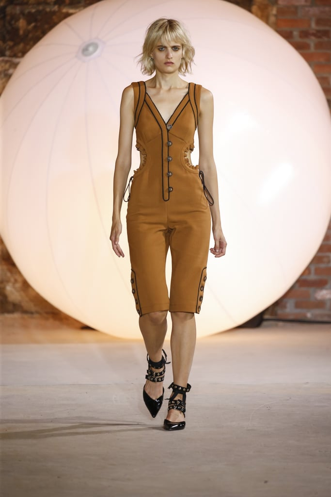 And Her Structured Playsuit Has Sexy Side Cutouts