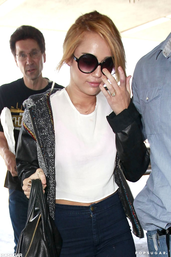 Miley Cyrus arrived at LAX showing off her engagement ring on her way to her flight.