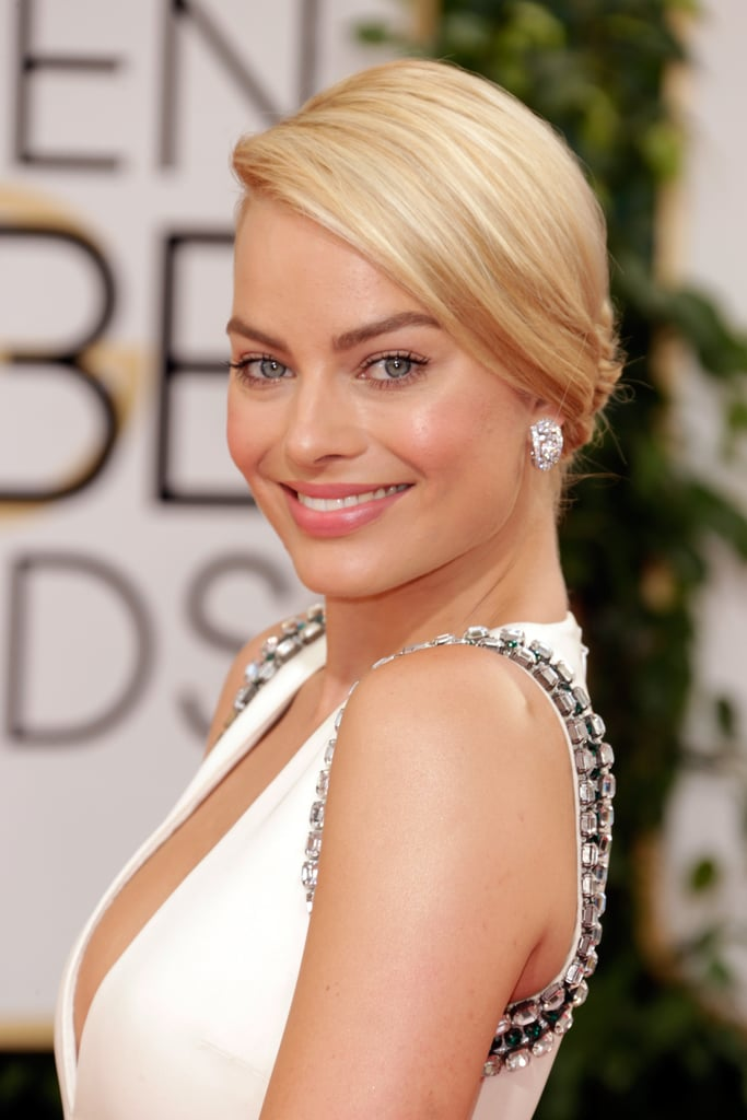 Margot Robbie let her natural beauty radiate through barely there makeup and a simple chignon.