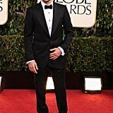 Bradley Cooper is all smiles at the Golden Globe Awards.