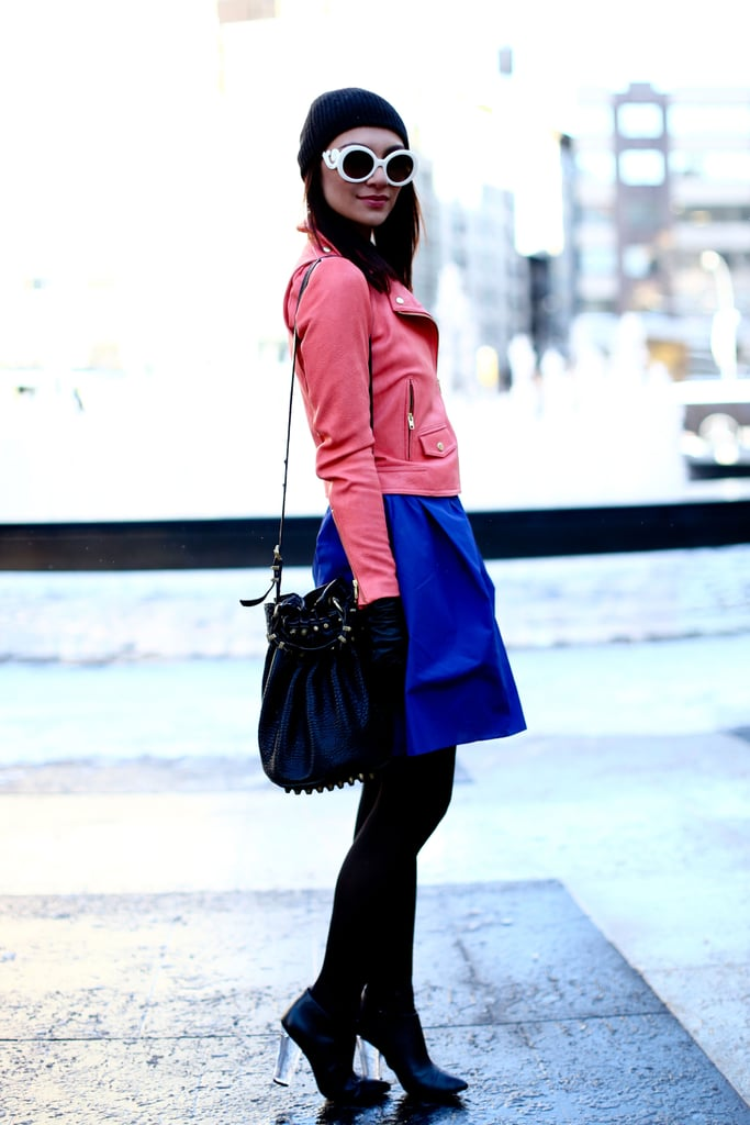 Coral leather looked infinitely cooler styled up with a cobalt skirt — a modern lesson in colorblocking.