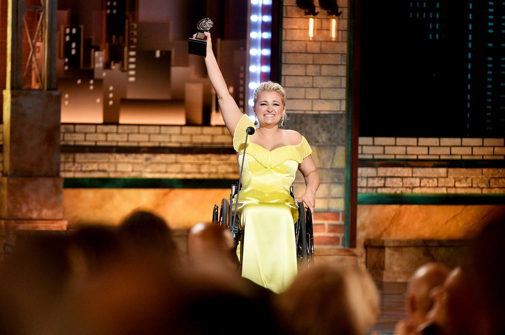 "Ali Stroker made history as the first actor in a wheelchair to be nominated and win a Tony Award when she took home best featured actress in a musical for her role as Ado Annie Carnes in the Oklahoma! musical revival. During the award show on Sunday, the 31-year-old took a moment to talk about the importance of representation when she accepted her award on stage. ""This award is for every kid who is watching tonight who has a disability, a limitation, a challenge, who has been waiting to see themselves represented in this arena. You are,"" she said.  The actress got her start on the competition show The Glee Project in 2012 and later guest-starred on season four of Glee. In 2015, she became the first actor in a wheelchair in Broadway history when she originated the role of Anna in the revival of Spring Awakening. Congrats to Stroker on her monumental award!"