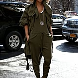 Miroslava Duma went utilitarian-chic in an olive jumpsuit and an anorak.