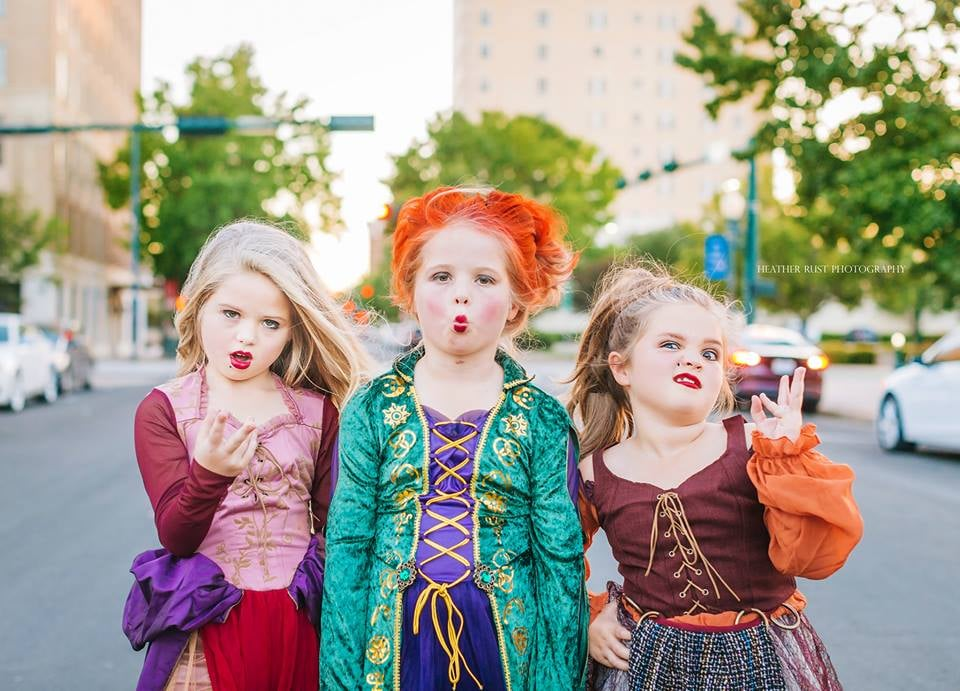 I smell children, Winnie . . . like, really adorable children dressed up in absolutely spot-freakin'-on Sanderson sisters costumes. The Grabenstein sisters of Waco, TX, 6-year-old Landri and 8-year-old twins Alli and Maddi, just crushed the Halloween game weeks before Oct. 31 — and we're not even mad about it. The sisters asked their mom, Heather, if they could watch Hocus Pocus on Oct. 1, and the rest appears to be history. The girls' costumes were done well ahead of Halloween, so Heather enlisted the help of Heather Rust, a Waco photographer, to snap photos of the girls, who get completely into character as Winnie, Mary, and Sarah. Check out the photos ahead to see how seriously incredible the girls' transformation into the Sandersons was. Related: Jenna Fischer Shared Our Ideal Office Halloween Costume, and BRB While We DIY 1 For Our Kids