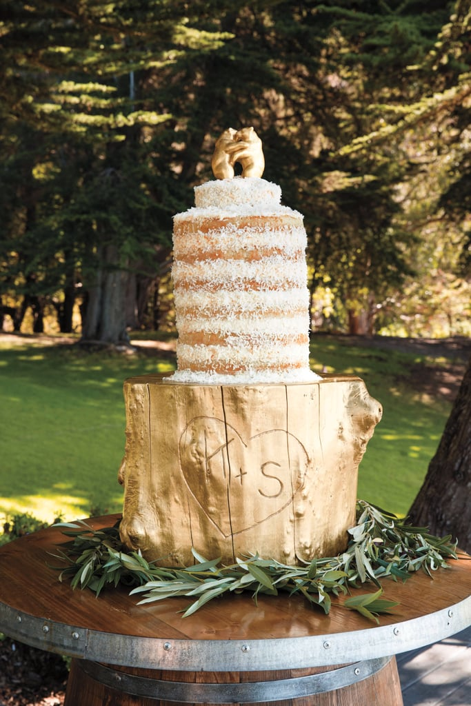 Gilded bear cake topper and stump cake stand