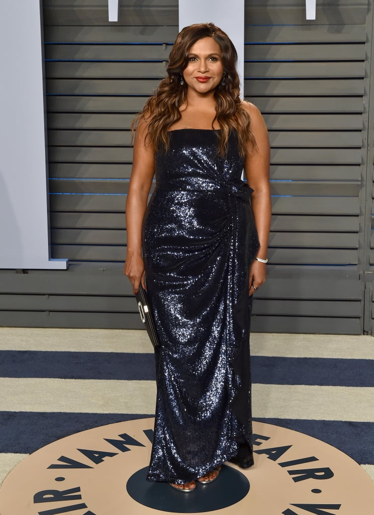 Mindy stunned at the 2018 Vanity Fair Oscars party in a strapless sequined Atelier Prabal Gurung dress and a matching Roger Vivier clutch.