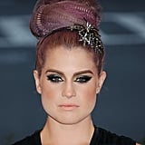 Kelly Osbourne mixed crimps and a starry hair accessory for this punk-chic topknot at the Met Gala.