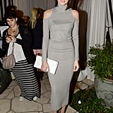 Kendall styled her mock-neck Donna Karan dress with suede pumps and a simple white envelope clutch.