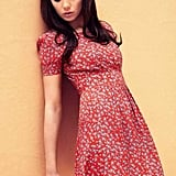 I love the lace trip on this red floral dress – so cute.