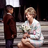 In May 1993, Diana got down on a little boy's level to accept a bouquet of flowers outside Great Ormond Street Hospital in London.