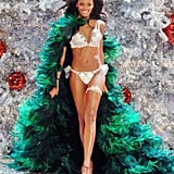 Selita Ebanks wore a peacock feather cape with her lingerie look in 2007.