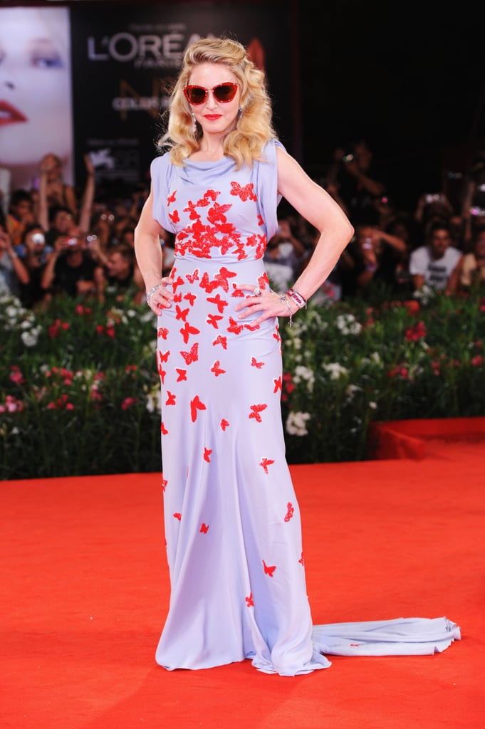 Madonna walked the W.E. red carpet in red shades.