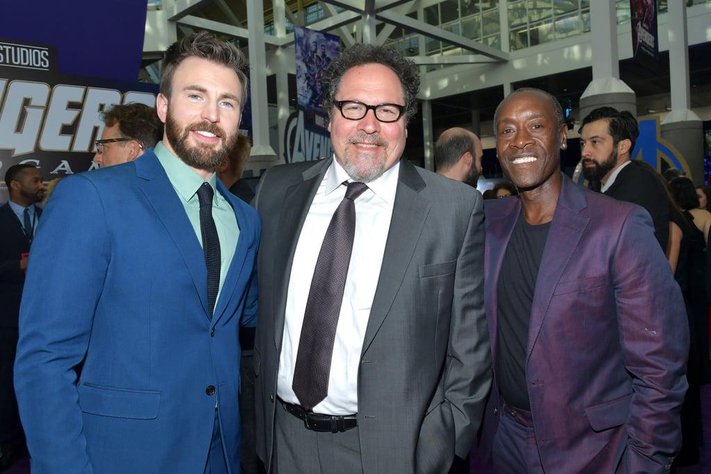 Pictured: Chris Evans, John Favreau, and Don Cheadle
