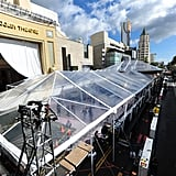 The plastic roof over the red carpet stood tall amid a break from the rain on Thursday.