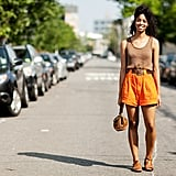 Summer is the season for going bold. Bright shorts offer a surprising pop of colour in a neutral look.