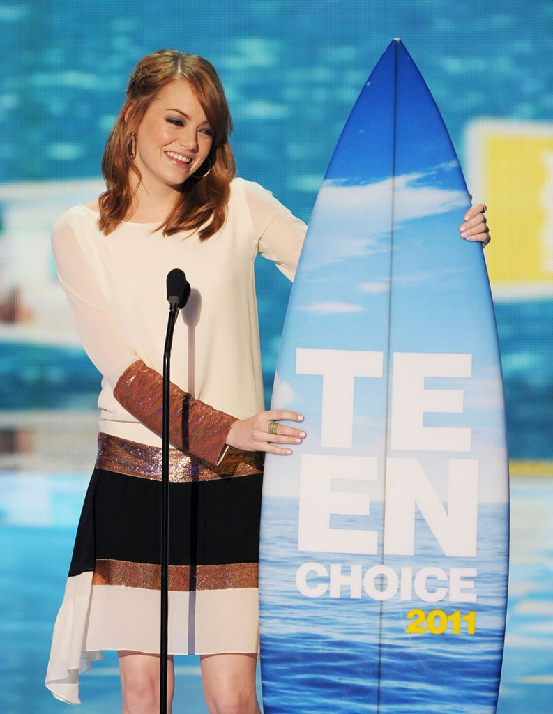 Emma Stone was happy to accept her surfboard on stage at the Teen Choice Awards in August 2011.