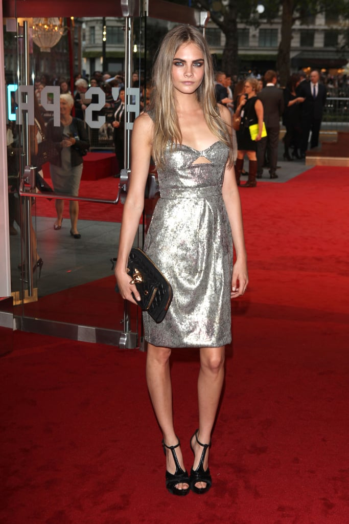 Cara Delevingne's metallic silver Burberry dress is a definite showstopper — play it cool accessory-wise with a simple black clutch and ankle-strap heels.