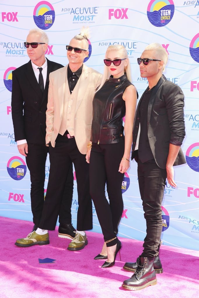 "Gwen Stefani was on the red carpet at this evening's Teen Choice Awards in LA. She was accompanied by her No Doubt bandmates, Tony Kanal, Tom Dumont, and Adrian Young, before the show began. The group has been waiting for today's show, since it's the event where they'll make their live music debut ahead of their comeback album's September release. Gwen and the guys are expected on stage to perform their new song ""Settle Down."" The full record, Push and Shove, is out Sept. 25. What do you think of Gwen's ensemble? Make sure to check out our Teen Choice Awards fashion roundup."