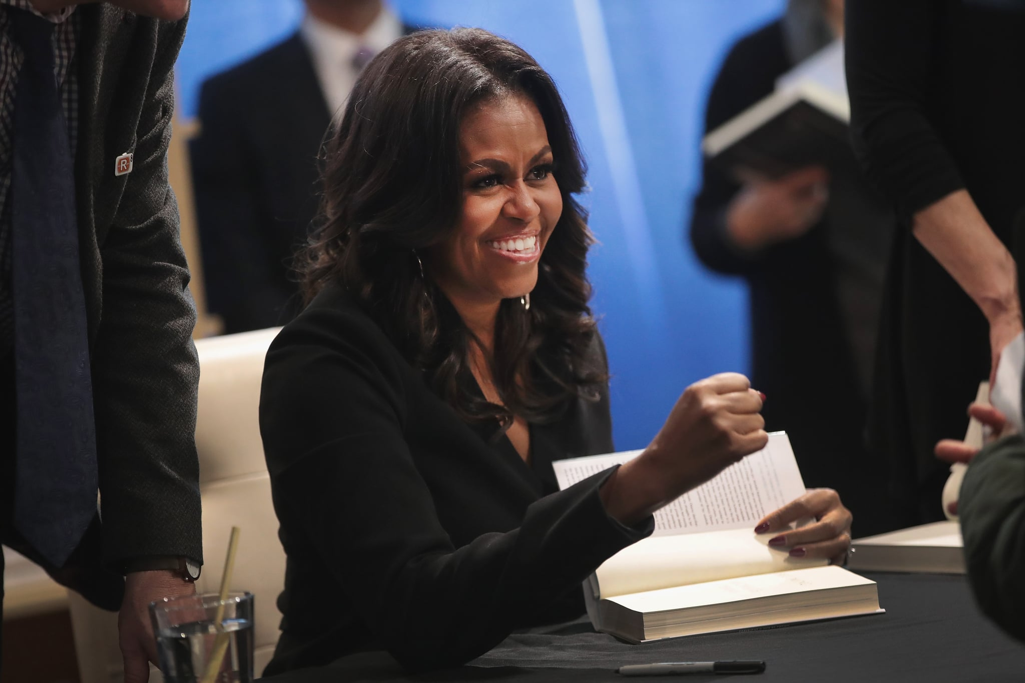 "CHICAGO, IL - NOVEMBER 13:  Former first lady Michelle Obama kicks off her ""Becoming"" book tour with a signing at the Seminary Co-op bookstore on November 13, 2018 in Chicago, Illinois. In the book, which was released today, Obama describes her journey from Chicago's South Side to the White House.  (Photo by Scott Olson/Getty Images)"