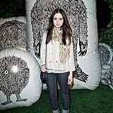 Lily Collins dressed up a jeans-and-white-sweater combo with a pretty Spring scarf and chunky platforms.