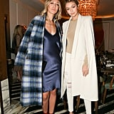 Gigi, pictured with her sister Alana, styled her distressed white jeans with a long white cape, beige shirt, and beige heels, making the Summer style staple look surprisingly holiday party appropriate.