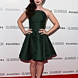 Lily Collins went with a forest-green Alexander McQueen strapless cocktail dress.