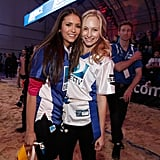 Nina Dobrev cuddled up to game opponent Candice Accola before the sixth annual Celebrity Beach Bowl Game in 2012.