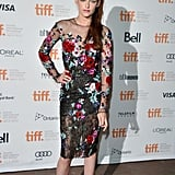 Kristen took a girlie turn in a knee-length floral-print dress from Zuhair Murad's couture collection at the Toronto Film Festival in September 2012.