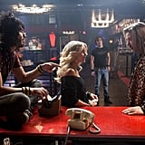 Julianne Hough, Russell Brand, and Alec Baldwin in Rock of Ages. Photos courtesy of Warner Bros.