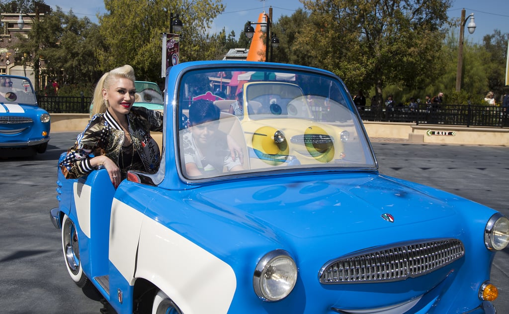 Following her epic duet with boyfriend Blake Shelton on The Voice, Gwen Stefani whisked her eldest son, Kingston Rossdale, away for a magical day at Disney California Adventure in Anaheim, CA, on Tuesday. While there, the duo was all smiles as they rode the new Luigi's Rollickin' Roadsters ride in Cars Land, adding to their long list of cute family moments. Over the weekend, Gwen turned Blake's LA Angry Birds movie premiere into a family affair, arriving with her two boys Kingston and Zuma and niece Stella Stefani in tow. Keep reading to see Gwen's fun day at the park, and then check out photos from when she visited Disneyland back in Novemeber.
