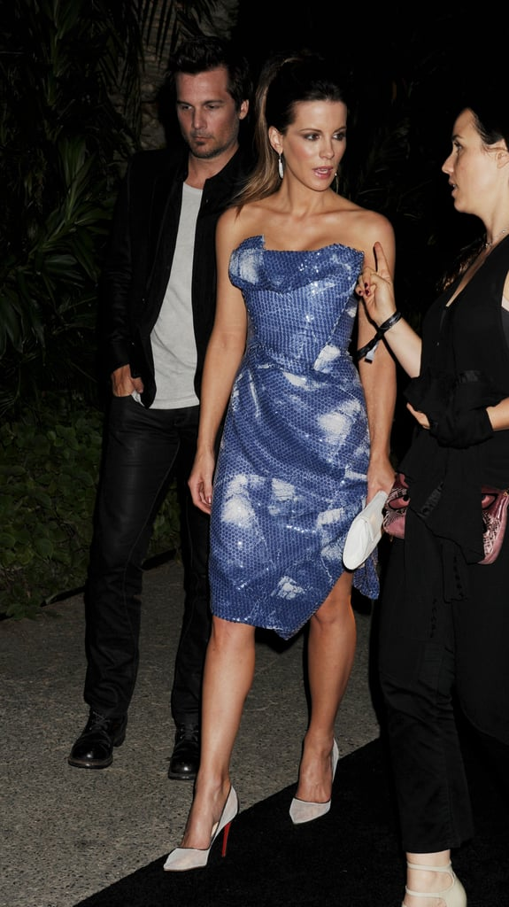 Kate Beckinsale got glamorous in a Vivienne Westwood dress to attend Porsche Design's 40th Anniversary event at a private home in LA last night. Kate's husband, Len Wiseman, was by her side for the outing that came after their busy promotional tour together this Summer. Len directed Kate's latest blockbuster, Total Recall, in which she starred opposite of Jessica Biel and Colin Farrell. The couple took the film around Europe with stops in Dublin, Berlin, and London earlier this month alongside both Colin and Jessica.