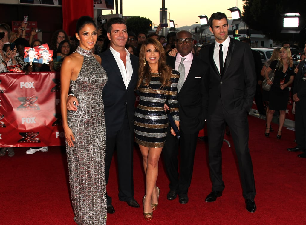 "Simon Cowell arrived in style for last night's screening of his new TV show, The X Factor, stepping out of his custom-built black Rolls-Royce to greet screaming fans at LA's ArcLight theater. He was the last judge to arrive on the red carpet and promptly received a kiss from his good friend Paula Abdul. X Factor reunites former American Idol judges Simon and Paula and introduces new faces L.A. Reid and Nicole Scherzinger and super-hot host Steve Jones, who's well known in the UK as a presenter. We were on hand for last night's exclusive screening of the first two episodes, which begin Sept. 21, and were happy to see Paula and Simon's infamous chemistry back in full force. L.A. adds his producing and songwriting expertise to the judging panel, while Nicole has a fresh point of view due to her years of touring the globe as a solo artist and with The Pussycat Dolls. Following the screening, the judges answered questions from fans, and according to Simon, he's finally ""met his match"" in fellow judge L.A. Here's more:  Simon on comparing the US to UK audiences: ""They [the US] have an amazing musical knowledge . . . they were very tough on us at times when we didn't love somebody. I thought there were moments when we were going to get mauled when the audience disagreed with us. The American audience is tougher than the UK audience."" Steve on hanging backstage with contestants: ""[One contestant] said I wear too much makeup and I'm nothing but a stretched Ryan Seacrest. And I was like, [sarcasm] 'Well, best of luck with your audition.'"" Paula on changing the lives of contestants: ""It's an overwhelming feeling, it's a blessing to see and to feel what other people feel when they're getting that moment. It's awe inspiring. Don't take it for granted."" On major arguments over contestants: Simon: ""I'm going to let you in on a little secret: when certain girls came to audition, if they were too attractive they were known as DOA, in other words dead on arrival, and from that, Nicole was christened Sylvester, from Sylvester the Cat, and Paula became Tom, from Tom and Jerry. So we had to fight, me and L.A., to keep the attractive girls in the competition because Sylvester and Tom didn't want them in the competition and that's where, true story, most of the arguments came from. L.A., will you back me up on that?"" L.A.: ""True story."" Simon on what the ""X Factor"" is: ""When someone is brilliant it's a no-brainer. Where it got tricky, as I said before, when other factors came into play, and that's where you needed myself and L.A. Reid to be fair and balanced. I got things back on track, but that's pretty much the only time we argued."" Simon on expanding the age range of contestants: ""[Joking with Paula] This show is all about giving older women a second chance."""