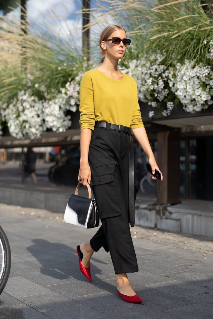In a cropped cut and understated color (like good ol' basic black), cargos are just as streamlined as your favorite slim-fit trousers, albeit infinitely cooler. Top them with an easy knit and finish with style-forward mules.