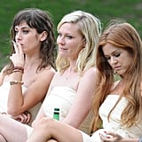 Kirsten Dunst, Isla Fisher, and Lizzy Caplan's characters looked a little bedraggled in a scene.