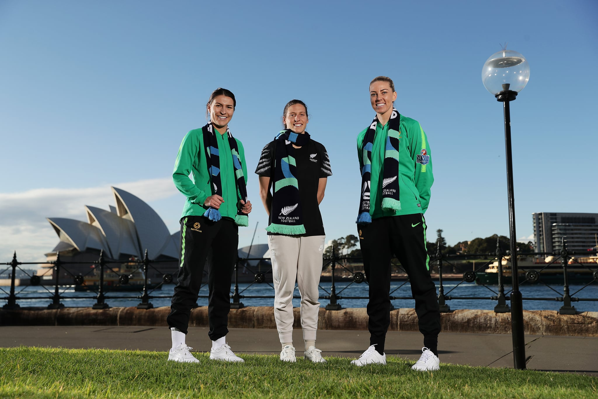SYDNEY, AUSTRALIA - JUNE 26: Alanna Kennedy and Steph Catley of the Matildas pose with Football Fern, Rebekah Stott during a media opportunity following the successful bid for Australia & New Zealand to host the 2023 FIFA Women's World Cup, at Hickson Road Reserve, The Rocks on June 26, 2020 in Sydney, Australia. (Photo by Mark Metcalfe/Getty Images)
