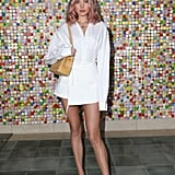 Elsa Hosk wearing a white dress and pumps at #REVOLVEfestival.