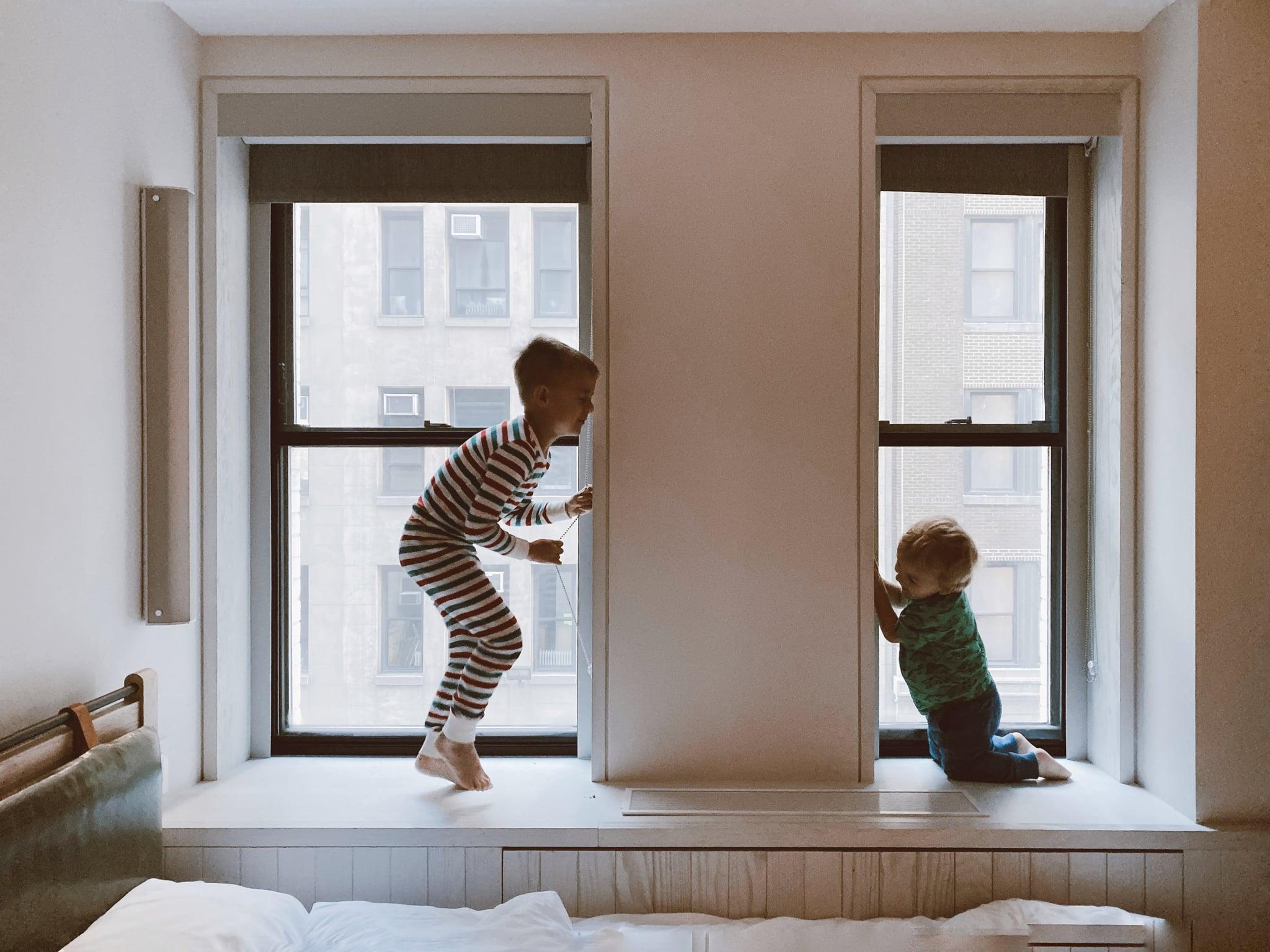 tmp_mBeS9g_2777e8187628ed1a_two-kids-playing-beside-glass-windows-3273851.jpg