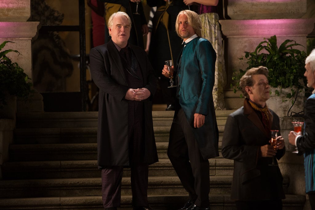 Philip Seymour Hoffman as Plutarch Heavensbee and Woody Harrelson as Haymitch in Catching Fire.